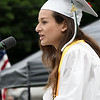 JIM VAIKNORAS/Staff photo Pentucket Class Treasurer Jessica Paszko gives the Invocation at the commencement at the school Saturday morning.