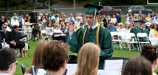 JIM VAIKNORAS/Staff photo Pentucket graduating senior Jacob Wengler conducts the band at the commencement at the school Saturday morning.