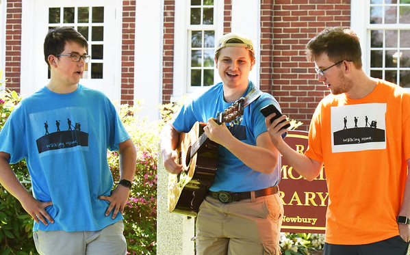 BRYAN EATON/Staff photo. Three Berwick Academy students are walking, in segments, from the Maine school to West Newbury in segments performing at their stops, here at GAR Memorial Library in West Newbury. From left, Gil Hamel, Greenland, N.H., Chris Yates, West Newbury and Ryan Brown of Groveland.