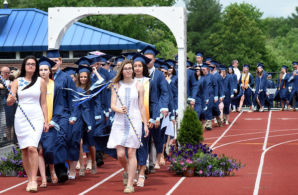 BRYAN EATON/Staff photo. The Triton graduates march into the stadium on Saturday.
