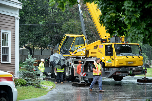 BRYAN EATON/Staff photo. OSHA was heading to the scene on Thursday morning at a scene where a tree worker fell at a job on Route 1A in Rowley at the intersection of Route 133.