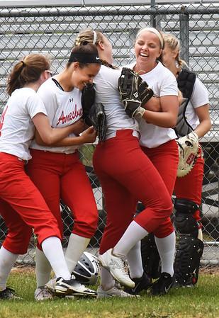 BRYAN EATON/Staff photo. Amesbury High School softball team celebrates their win 4-2 over St. Mary's.