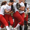 BRYAN EATON/Staff photo. Amesbury High School softball team celebrates their win 4-2 over St. Mary's.