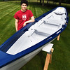 BRYAN EATON/Staff photo. Reece Ciampitti has finished his Eagle Scout project where he restored this 1910 Atlantic style dory for use at Merrohawke Nature Camp.