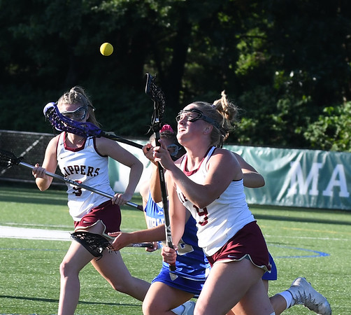 JIM VAIKNORAS/Staff photo Newburyport's Katelyn Hadden controls the ball the Clippers 14-11 lose to Norwell in the State semi-final game at Babson College Tuesday night.