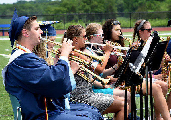 BRYAN EATON/Staff photo. The Triton High graduates perform the Star Spangled Banner with the underclassman and playing several other selections for the last time with them.