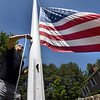 BRYAN EATON/Staff photo. John Tedoldi respects the U.S. Flag and what it stands for, so has been flying an oversized eight-by-twelve foot flag at his South Hampton Road, Amesbury home for almost 46 years. The pole is made of two sections that he salvaged and had welded together in 1973. One was a light pole at the old Amesbury Hospital that was hit by a car in 1972, and an emergency phone pole on Interstate 495 that met a similar fate in 1973. He changes the flags about every four years as they get worn out.