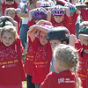 JIM VAIKNORAS/Staff photo Kids do a a pre-ride stretch at the 7th annual PMC Kids Ride in Newburyport Sunday. Over 125 kids, ages 3-13 participated in the event to raise money for cancer care and research.
