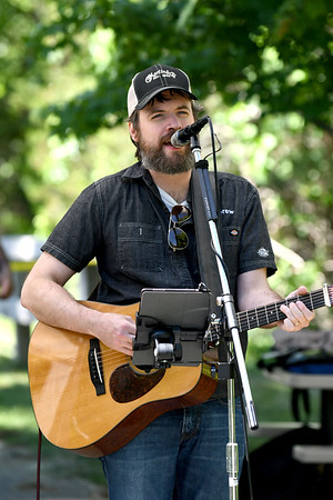 JIM VAIKNORAS/Staff photo Ryan Fitzsimmons of Amesbury performs on the Rail Trail in Salisbury at the annual Art Walk Sunday morning.
