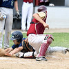 JIM VAIKNORAS/Staff photo Newburyport's  Kenny Hodge tags out Essex Tech player Ben Condon during their game Saturday in Newburyport. The Clippers won the game 3-0,