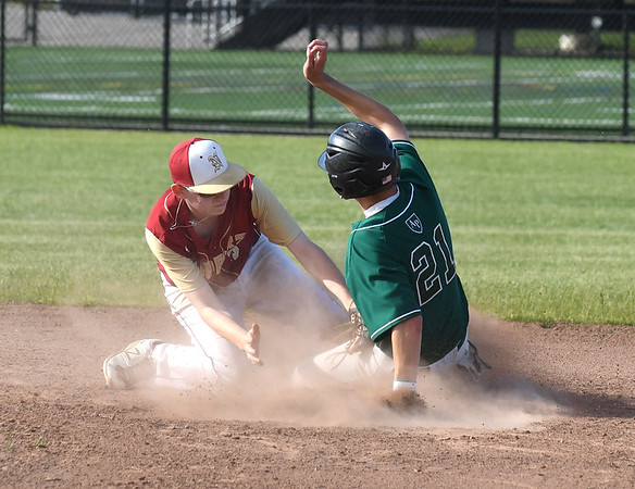 JIM VAIKNORAS/Staff photo  Newburyport's Jack Doyle tags out Austin Prep's Jake Thain on a steal attempt during their game at Melrose high Sunday afternoon.