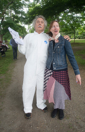 "JIM VAIKNORAS/Staff photo Charlie Tontar and organizer Jen Collins dressed as Doc Brown and Lorraine Baines from the movie ""Back to the Future"" at a fund raiser for the stone tower at Atkinson Common in Newburyport Saturday. The event featured a beer garden, Beatles music, a food truck, games, and classic cars."