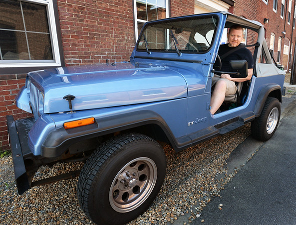 BRYAN EATON/Staff photo. Mike Brown took two years to convert this 1989 Jeep Wrangler into an electric vehicle.