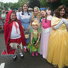 JIM VAIKNORAS/Staff photo Actors from the Amesbury Community Theater dressed up at the Amesbury Day's Block Party Thursday Night a the Main Street Congregational Church. From the left: Keira Steinel as Little Red Riding Hood, Sophia Saraiva as Dorothy, Jacqueline as Tinker Bell, Ava Connors as Alice, Annabelle Graham as Aurora and Kaileigh Steinel as Belle.