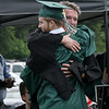 JIM VAIKNORAS/Staff photo Pentucket graduating senior William McDonough hugs class advisor John Siegfried after getting his diploma at the school Saturday morning.