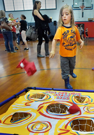 BRYAN EATON/Staff photo. Sky Sitzer, 4, of West Newbury plays the Soft Cover Bean Bag Toss at Amesbury Days' Kids Day in the Park held at Amesbury Middle School.