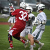 BRYAN EATON/Staff photo.  Hazen Pike and Connor Melone defend a Saugus player.