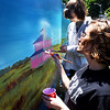 "BRYAN EATON/Staff photo. Pentucket students Katie Rosa, 16, back, and Casey Pratt, 15, paint the ""pink house"" on Plum Island Turnpike."