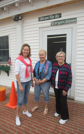 JIM VAIKNORAS/Staff photo Nancy Frick, Maryann Hatfield, and Sandra Cyr infront of Steppe Up In thrift shop in Amesbury.