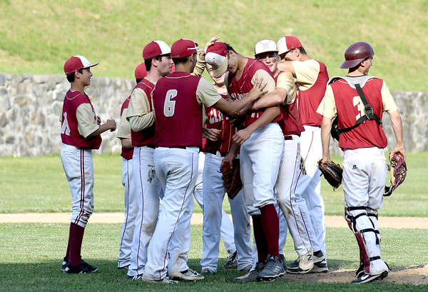 JIM VAIKNORAS/Staff photo Newburyport's Casey McLaren is swarmed by his teammates after the Clipper's game against Watertown Friday at Pettingell Park in Newburyport. Newburyport won the game 3-0.