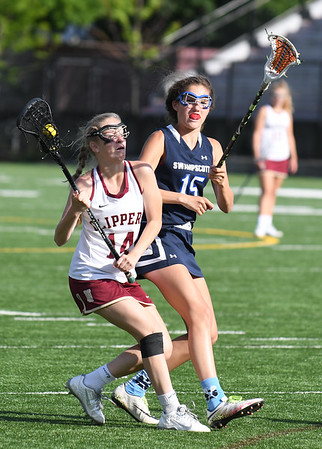JIM VAIKNORAS/Staff photo Newburyport's Emily Laliberty makes a move against Swampscott's Nikki Rosa during their game at World War Memorial Stadium in Newburyport Tuesday.