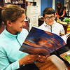 BRYAN EATON/Staff photo. Reese Renda, 11, left, and John Dwyer, 12, check out their completed books, hers on the Atlantic and his on the game of basketball in Nicole LaPerrier's class at the Pine Grove School in Rowley. The sixth-graders picked a subject, then wrote, designed with some doing illustrations--having glossy copies made--on life in the United States to send to students in Kenya give them information about the country.