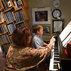 BRYAN EATON/Staff photo. Penny Lazarus, who teaches piano out of her home in Newburyport, and her students, including Harry Meure, 10, are collecting music books to send to Albania.