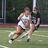 JIM VAIKNORAS/Staff photo Newburyport's Samantha King out races Manchester-Essex player Christina Calandra during the first half of the North Final against  at Triton in Byfield. Newburyport won the game 17-8.