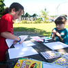 JIM VAIKNORAS/Staff photo Fiona Mahon, 7, and Bree Buxbaun ,10, make Get Well Soon cards for cancer patients  at the 7th annual PMC Kids Ride in Newburyport Sunday. Over 125 kids, ages 3-13 participated in the event to raise money for cancer care and research.