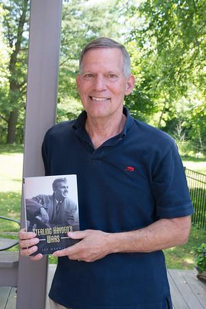 """JIM VAIKNORAS/Staff photo  Lee Mandel with his book """"Sterling Hayden's Wars"""" at Hayden son's home in Newburyport."""