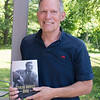 "JIM VAIKNORAS/Staff photo  Lee Mandel with his book ""Sterling Hayden's Wars"" at Hayden son's home in Newburyport."