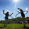 BRYAN EATON/Staff photo. Genevieve French, left, and Gabi Peixoto, both 10, do the hula hoop as physical education classes at Amesbury Elementary School were held outside under a bright sky Thursday. It's likely that it's the best day of the next five as it gets a little humid with a slight chance of a shower tonight or tomorrow morning with some sun and clouds the rest of the weekend with rain on Monday.