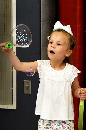 BRYAN EATON/Staff photo. Beatrice Stanley, 6, from Pennsylvania, plays at the Bubble Station at Kids Day in the Park while visiting relatives in the area.