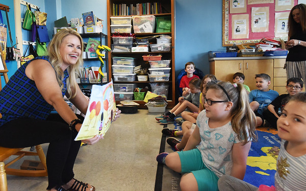 """BRYAN EATON/Staff photo. Author Ann Biese, a resident of Newburyport, reads her book """"Worry Bee"""" to students at the Page School in West Newbury."""