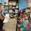 "BRYAN EATON/Staff photo. Author Ann Biese, a resident of Newburyport, reads her book ""Worry Bee"" to students at the Page School in West Newbury."