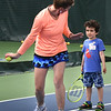 BRYAN EATON/Staff photo. Connor Sands, 5, listens intently as Hillary O'Connor gives instruction in his swing.