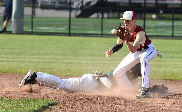 JIM VAIKNORAS/Staff photo  Newburyport's Thomas Murphy waits on the throw as an Austin Prep player dives safely back to 2nd  during their game at Melrose high Sunday afternoon.