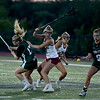 JIM VAIKNORAS/Staff photo Manchester-Essex player Mary Delisio and Samantha Booma fight for a loose ball with Newburyport's Molly Rose Kearney and Maggie Pons during the North Finals game at Triton in Byfield Friday night. Newburyport won the game 17-8.