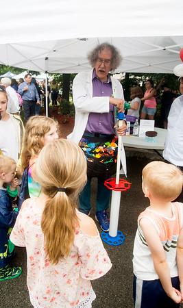 JIM VAIKNORAS/Staff photo Bruce Lawson makes balloon animals at the Amesbury Day's Block Party Thursday Night a the Main Street Congregational Church.