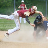 JIM VAIKNORAS/Staff photo Newburyport's Thomas Murphy turns a double lay as Essex Tech player William Preshong slides into second during their game Saturday in Newburyport. The Clippers won the game 3-0,