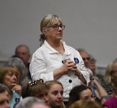 JIM VAIKNORAS/Staff photo  Joan Cosselman of Newbury asks Senator Elizabeth Warren a question about immigration at Newburyport High School Saturday morning.