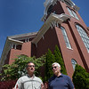 BRYAN EATON/Staff photo. Reverend Chris Ney, left, with board member and project manager Jim Robins.