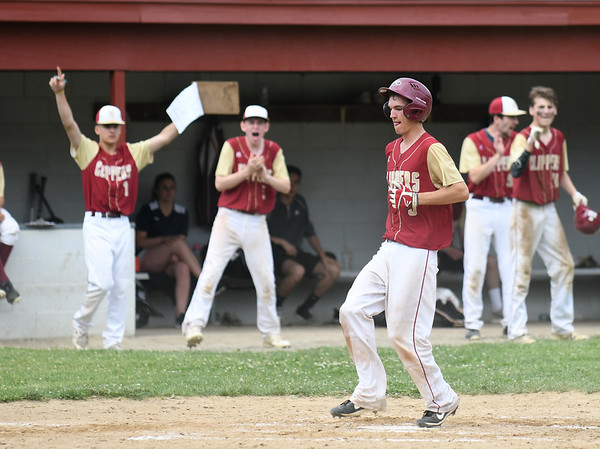 JIM VAIKNORAS/Staff photo Newburyport's bench cheers as Kenny Hodge scores against Essex Tech during their game Saturday in Newburyport. The Clippers won the game 3-0,