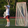JIM VAIKNORAS/Staff photo Newburyport's Molly Laliberty looks back into the sun during the first half of the North Final against Manchester Essex at Triton in Byfield. Newburyport won the game 17-8.