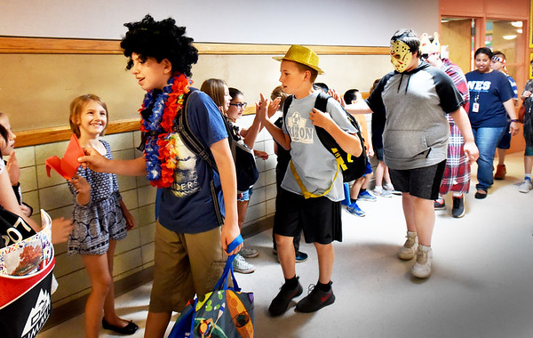 BRYAN EATON/Staff photo. Newbury Elementary School sixth-graders, some in costumes, parade through the hallways saying goodbye to underclassmen, as they'll be heading to Triton Regional Middle School in the fall. Tuesday was the last day of classes in the Triton Regional District which also includes Rowley and Salisbury.
