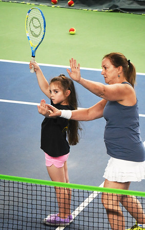 BRYAN EATON/Staff photo. Bentlee Dragon, 5, of Salisbury gets instruction from Joni Stone in posture and serving the ball.