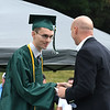 JIM VAIKNORAS/Staff photo 	<br /> Michael J. Jones President and CEO of the Institution for Savings awards teh banks scholarship to Pentucket graduating senior Kyle Costello at the school Saturday morning.