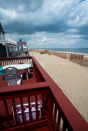 JIM VAIKNORAS/Staff photo Tom Saab looks out from one of his rental properties on Salisbury Beach.