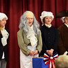 "BRYAN EATON/Staff photo. Cashman Elementary School third-graders put on the musical play ""The British Are Coming"" re-enacting some historical events leading up to the Bill of Rights in a performance for parents at the Amesbury school on Wednesday morning. Presenting one scene are, from left, Patriots Faith Mainville, Lucas Zepf as Ben Franklin, Julliana Nocifora and Greg Harris."