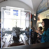 BRYAN EATON/Staff Photo. Custom House Maritime Museum intern Quinn Campbell, of Newburyport, right, is giving tours this week at the museum to school groups before they go onto the replica ship Nao Santa Maria. Here she shows the room showcasing the U.S. Coast Guard after a room on local shipwrecks and one on World War II.